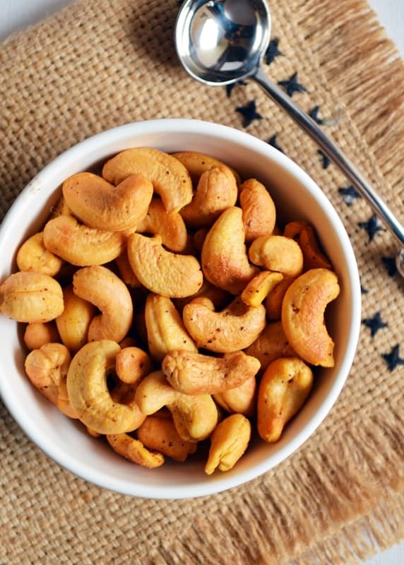 Crispy golden roasted cashews served with a spoon