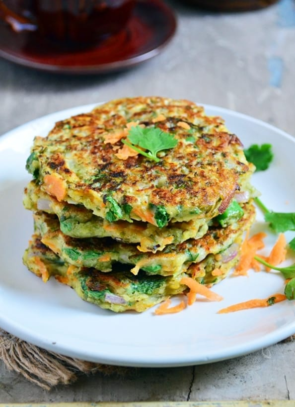 stack of healthy and tasty moong dal chilla served in a white plate for breakfast.