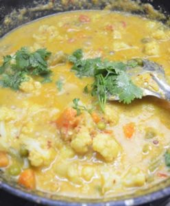 garnish with cilantro for mixed vegetable korma