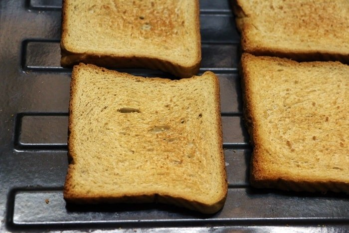 toasting bread slices