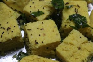 tempering poured over steamed and sliced khaman