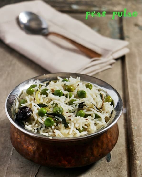peas pulao or matar pulao served in a copper bowl with a spoon for lunch