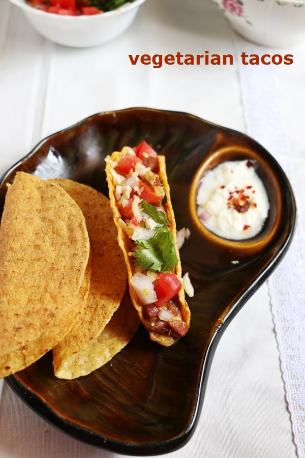 Easy homemade vegetarian tacos served with a cream dip.