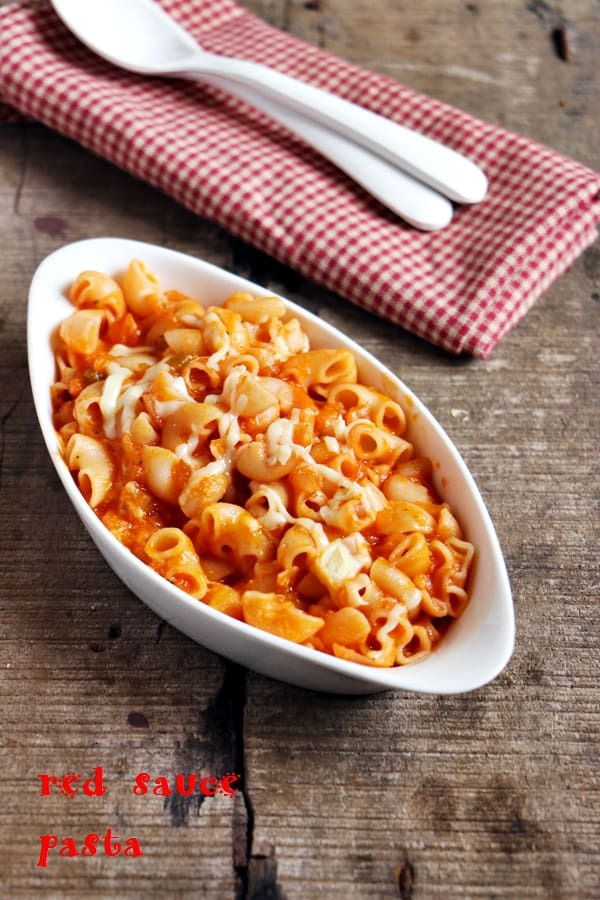 Red sauce pasta served in a white bowl for dinner