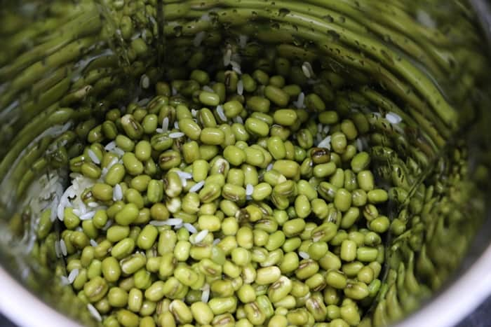 soaked whole green gram or moong dal and rice in a mixer jar.
