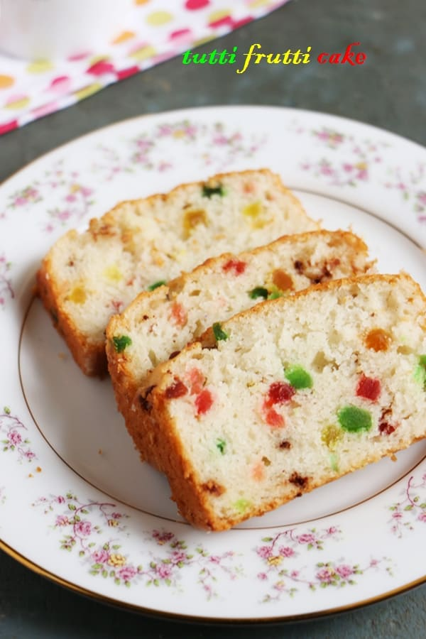 Thick slices of homemade eggless tutti frutti cake