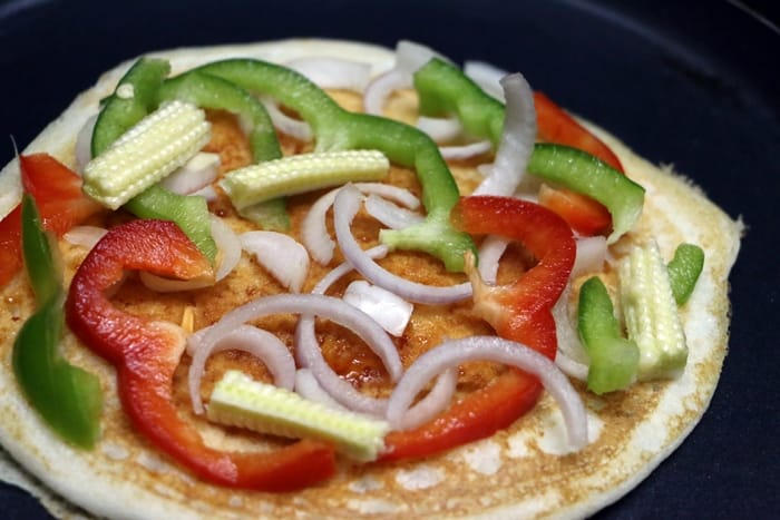 Dosa pizza! soft uthappa topped with vegetables