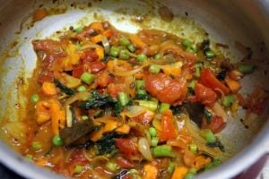 mixed vegetables cooked with spice powders for tomato bath