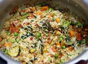 soaked and drained rice added to mixed vegetables