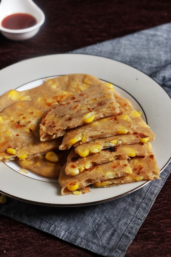 cheese paratha sliced into wedges