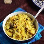 fresh kanda batata poha or aloo poha served in a ceramic bowl