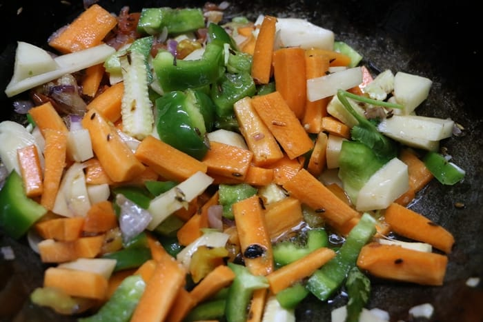 Sauteing the mix veggies in masala for mix veg recipe