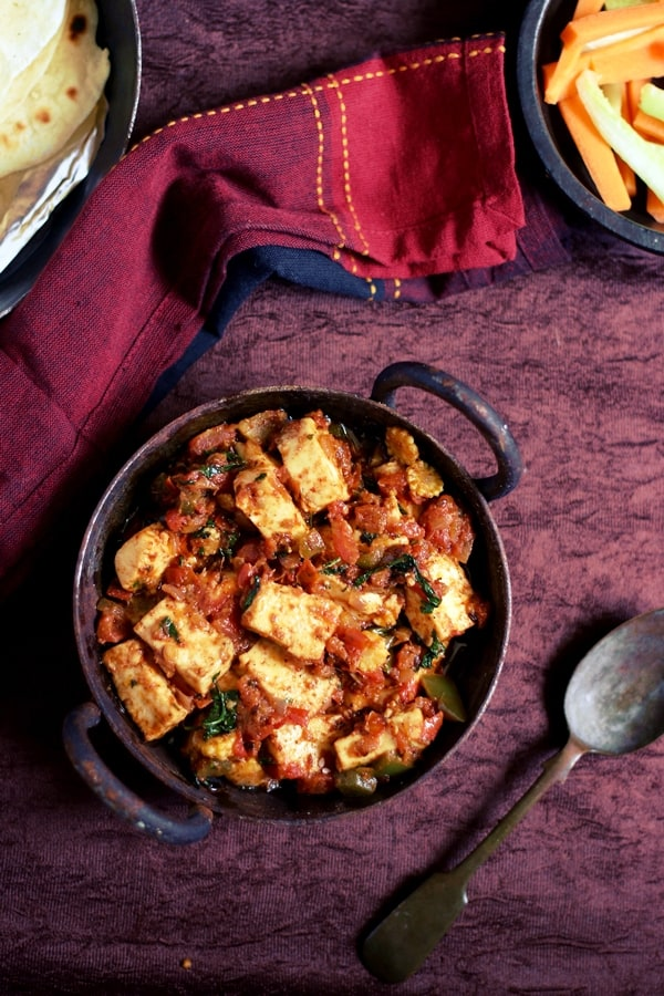 Overhead shot of easy paneer masala served in a cast iron pan