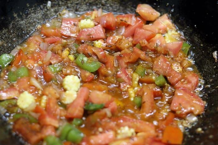 cooking veggies in oil for paneer masala