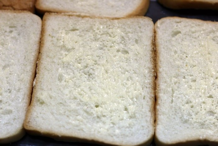 Butter bread slices for making garlic toast