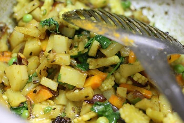 Sauteing veggies for making veg tahiri recipe