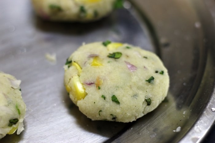 shaped batata vada ready to be fried