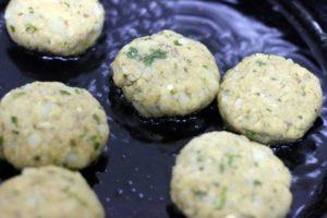 shallow frying aloo tikki in cast iron tava
