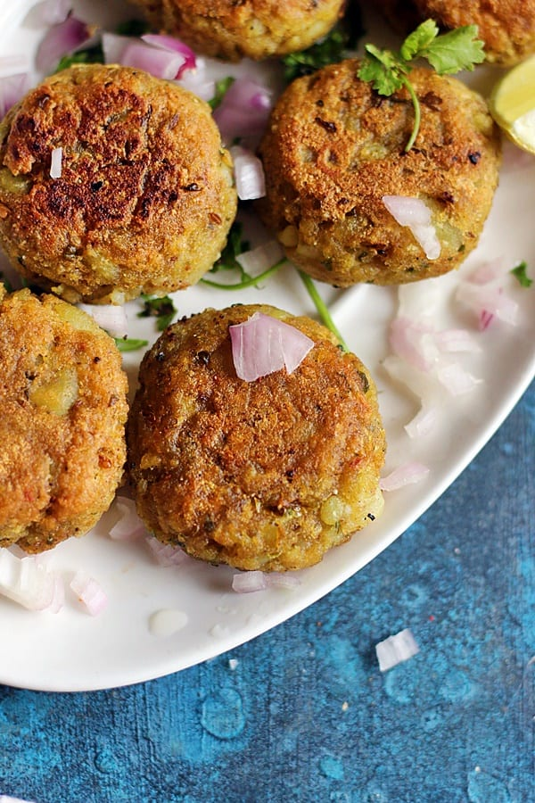 aloo tikki served with finely chopped onions