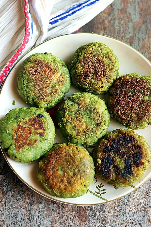 a white plate full of fresh homemade hara bhara kababs for snack