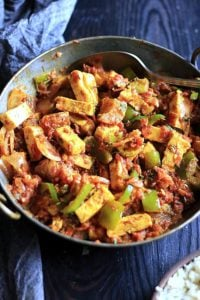 delicious semi dry kadai paneer served in a copper pan