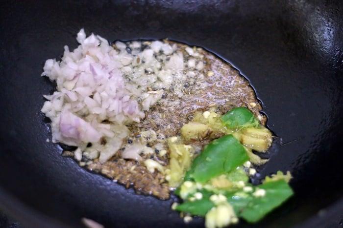 sautéing onion, ginger garlic and green chili in butter in a kadai