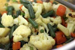 Making vegetable korma recipe