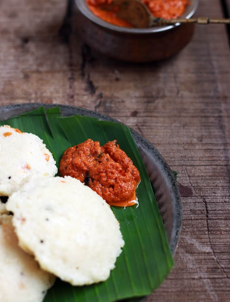 kara chutney served with idli on banana leaf for breakfast.