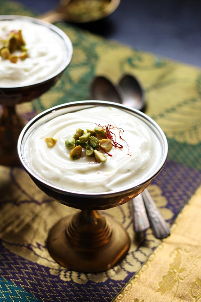 Fresh creamy homemade shrikhand served in two dessert bowls with spoons.