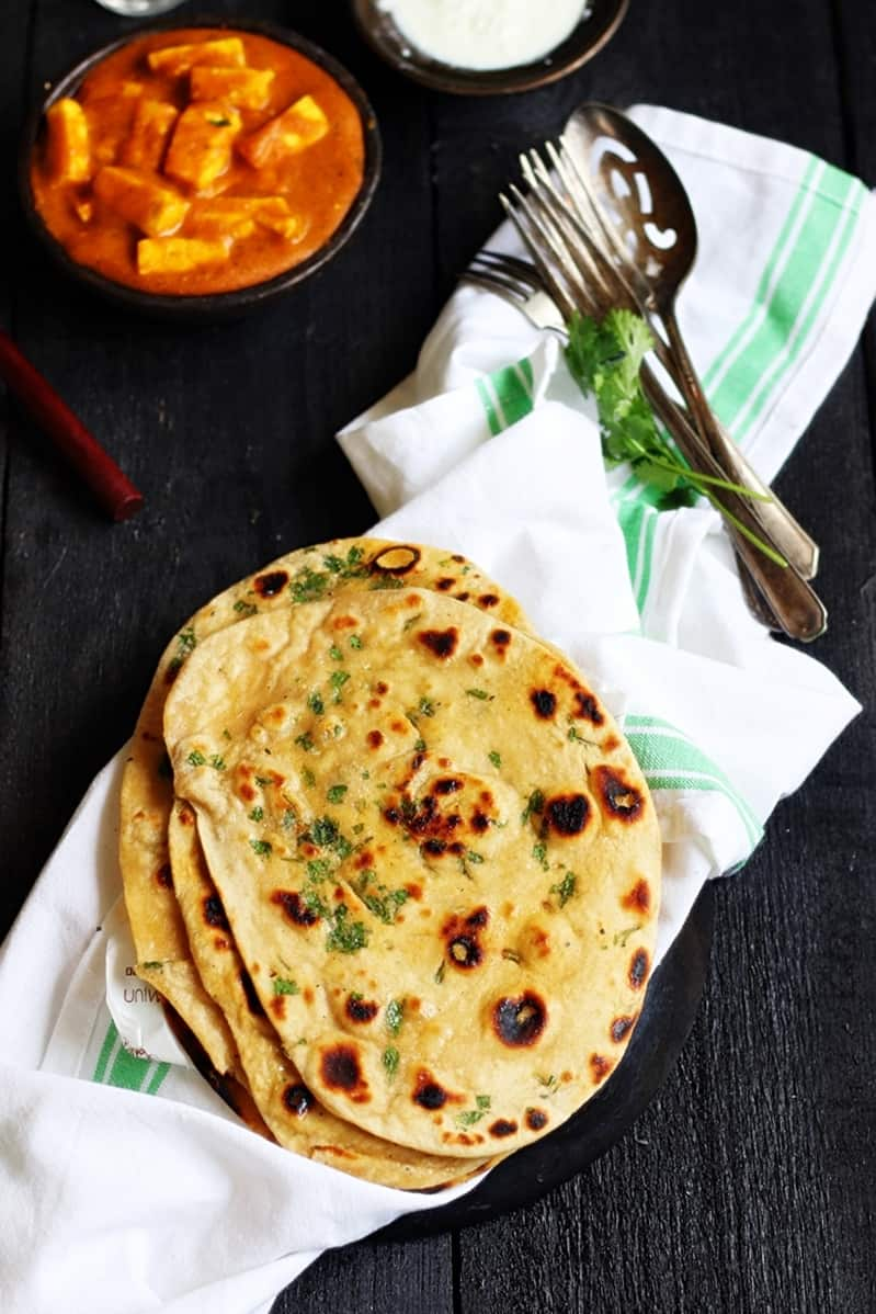 homemade naan bread served with paneer curry for dinner
