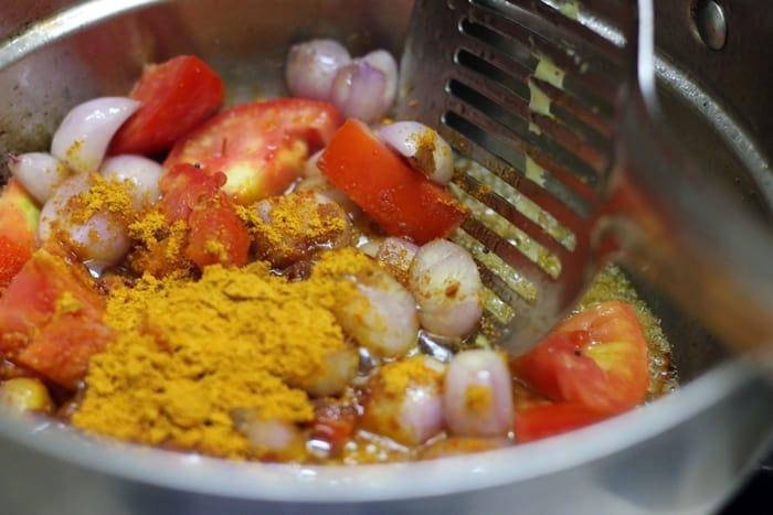 Adding spice powders for hotel sambar recipe