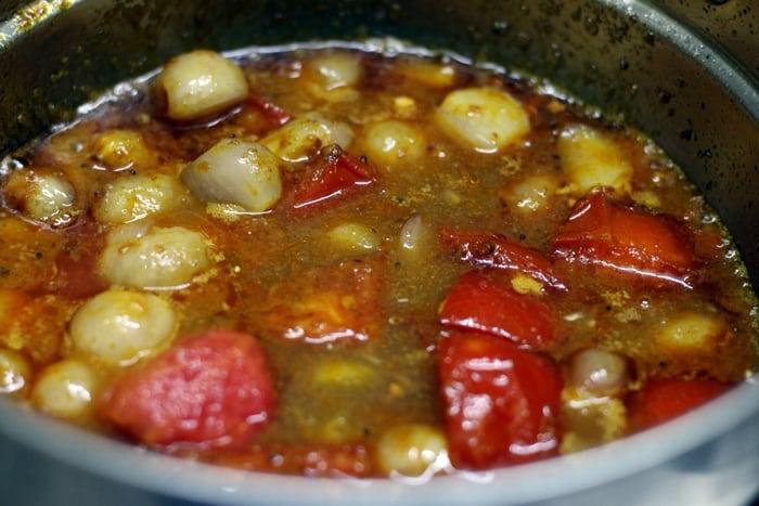 Adding tamarind extract for hotel sambar recipe