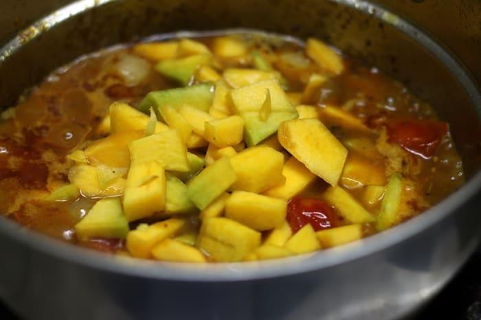 Making hotel sambar- adding dal and pumpkin pieces