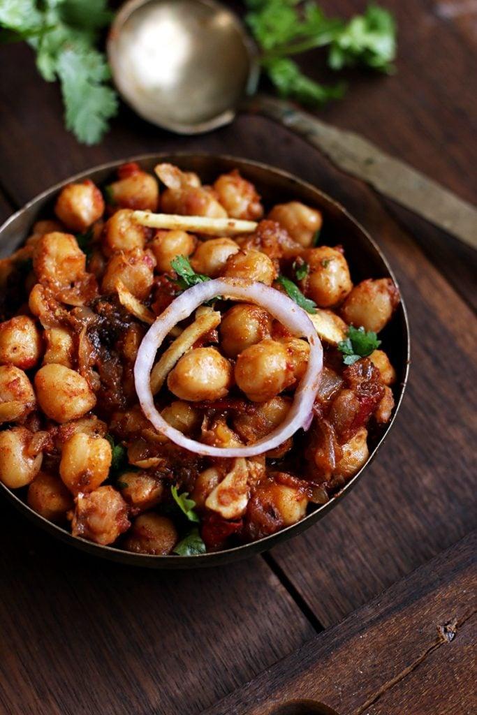 punjabi chole masala or chana masala served with onion rings