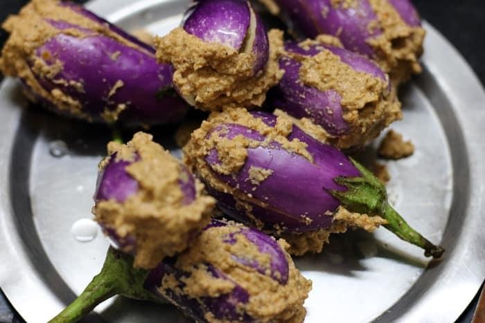 Eggplants stuffed with spice paste for making bharli vangi recipe