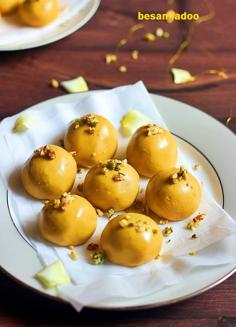 Shiny besan ladoo arranged in a white plate for dessert