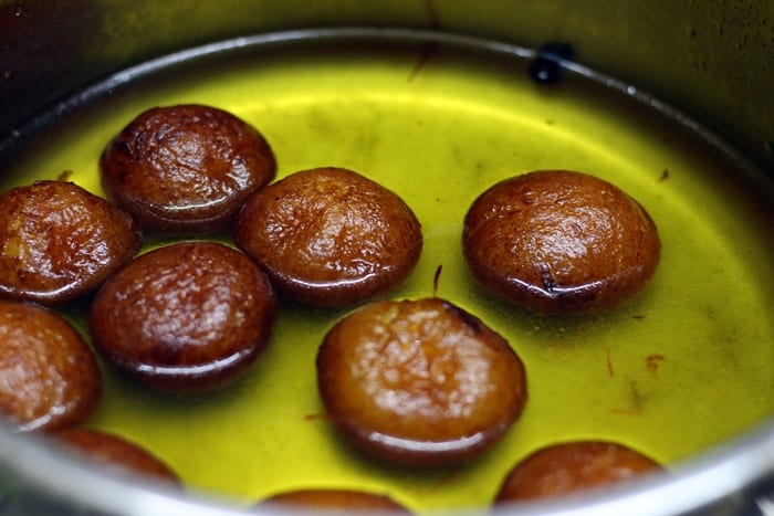 fried jamuns soaked in sugar syrup