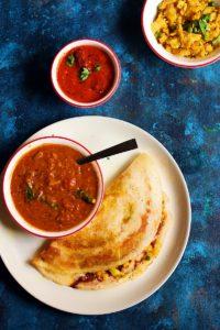 overhead shot masala dosa served with sambar and chutney