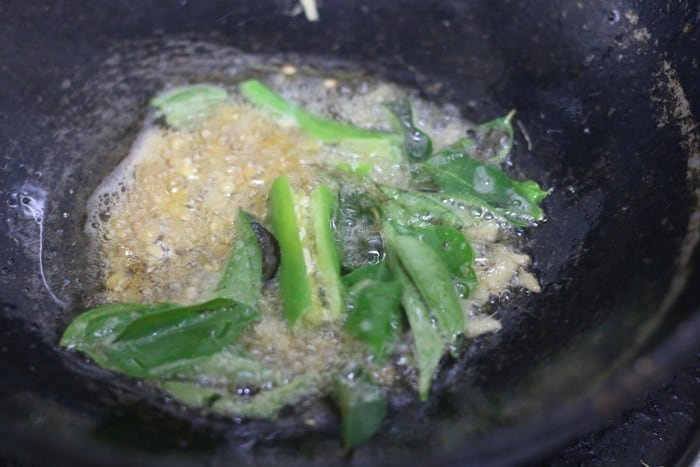 curry leaves added to the tempering of thakkali sadam