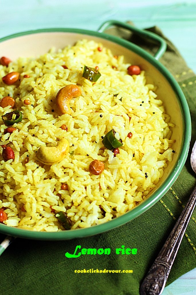 South Indian lemon rice served in green rimmed enamel pan