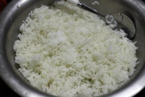 rice tossed with oil and salt for making lemon rice