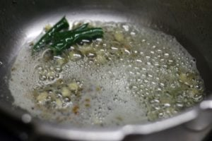 sautéing green chilies and ginger garlic