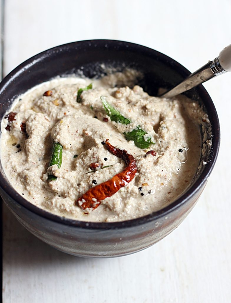groundnut chutney served in a small bowl with a spoon