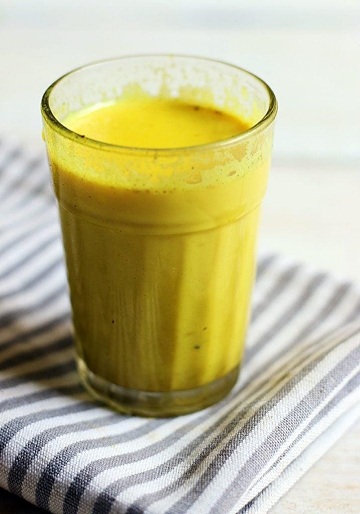 closeup shot of golden milk in a glass