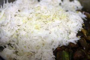 cooked rice added to sauteed brinjals