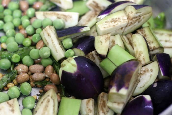 chopped brinjals and green peas added