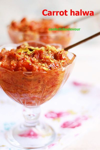 Carrot halwa recipe- a glass bowl containing carrot halwa garnished with fried nuts.