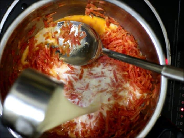 milk added to sauteed carrots for carrot halwa