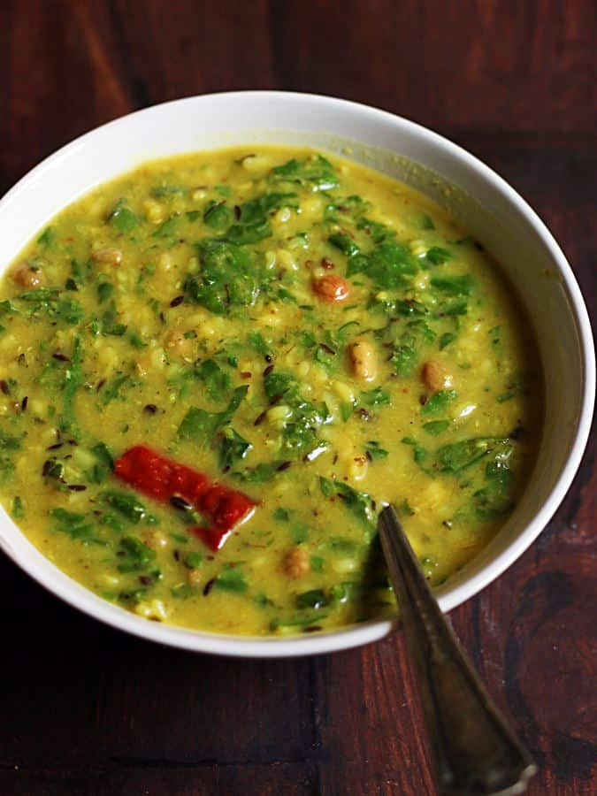 Closeup shot of delicious palak dal served in a white bowl