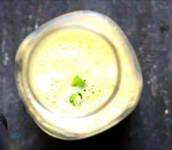 adding green chilies for kulukki sarbath recipe